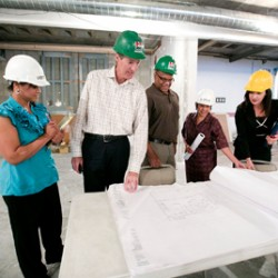 CEO Doug Bennett tours the construction site showing employees future plans for new work spaces.
